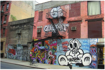 The cost to taxpayers of preventing and removing graffiti, like this example from New York City's Lower East Side, is staggering. Photo courtesy of Summ, via Wikimedia Commons.